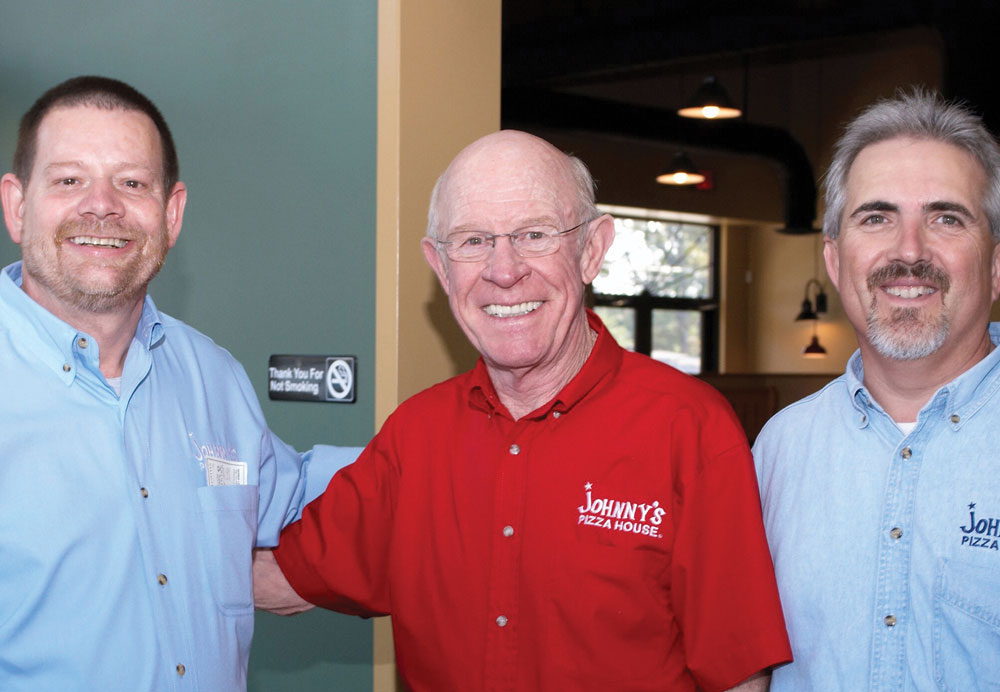 From left: Bernie Lear, chairman of the board at Johnny's Pizza House; company founder Johnny Huntsman; and Melvin DeLacerda, president and CEO.