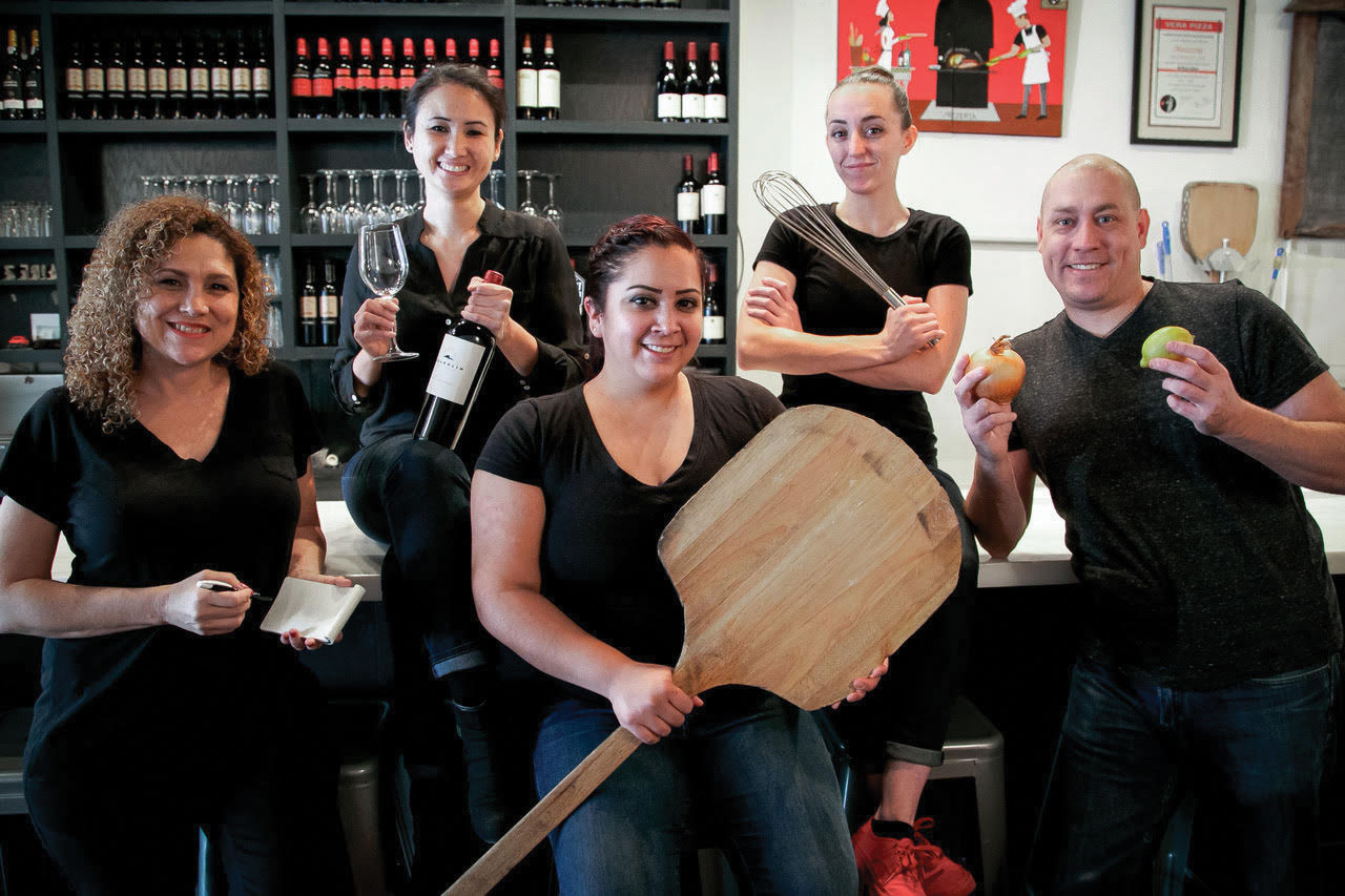 this photo shows the staff, all of whom are deaf, at Mozzeria
