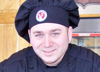 this photo shows the man who has developed a process for seasoning Detroit-style pizza pans