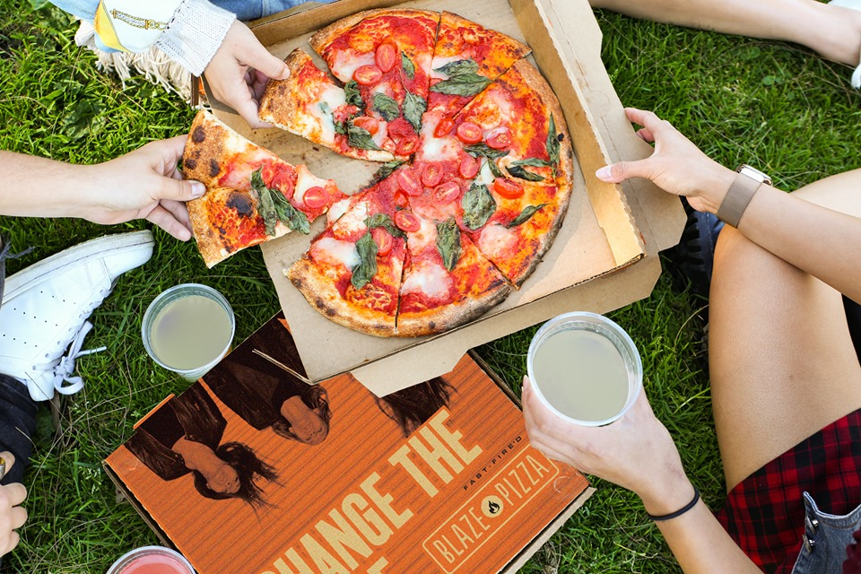 this photo of a large pizza illustrates a new selling point for Blaze Pizza