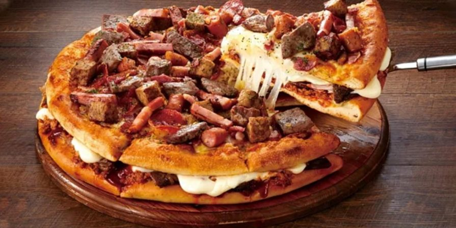 pizza piled with meat