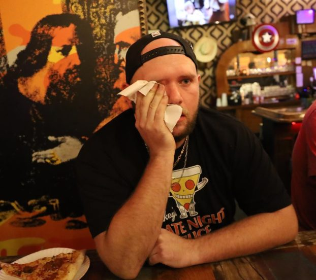 this photo illustrates the challenge of eating the world's hottest pizza at Mikey's Late Night Slice