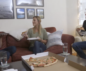 people enjoying a pizza