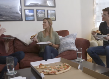 people enjoying a pizza
