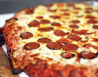 The pies at Bocce Club Pizza have been made in the classic Buffalo style for decades.