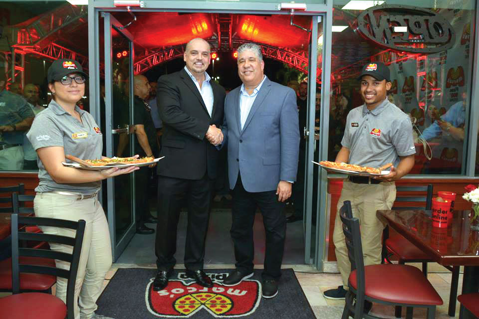 Marco's Pizza president Tony Libardi (left) and area representative Carlos Budet showed up for the opening of the chain's 900th store last year in Bayamón, Puerto Rico.
