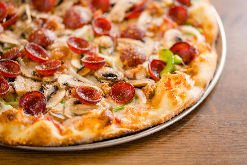 The E&D Special (above) features mushrooms, onions, green peppers, bacon, Italian sausage and pepperoni