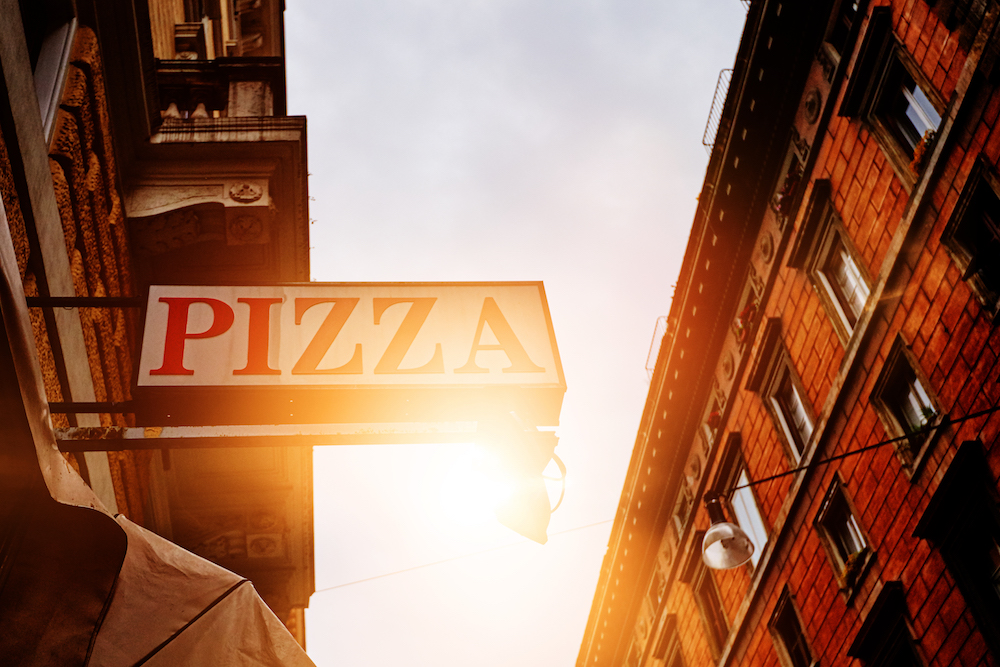 this photo depicts how signage matters in the location of a pizzeria