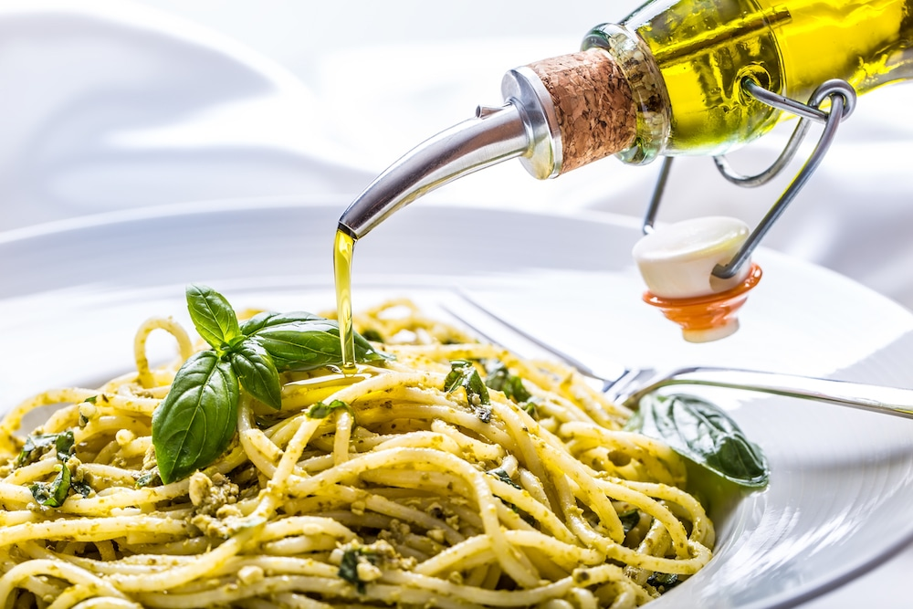 this is a beauty shot of olive oil with pesto spaghetti