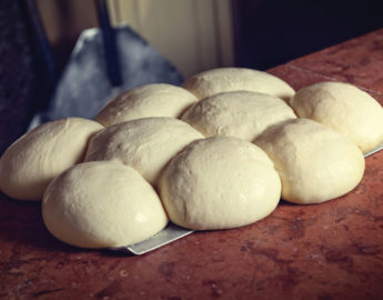 this photo illustrates the importance of getting pizza dough balls into the cooler quickly