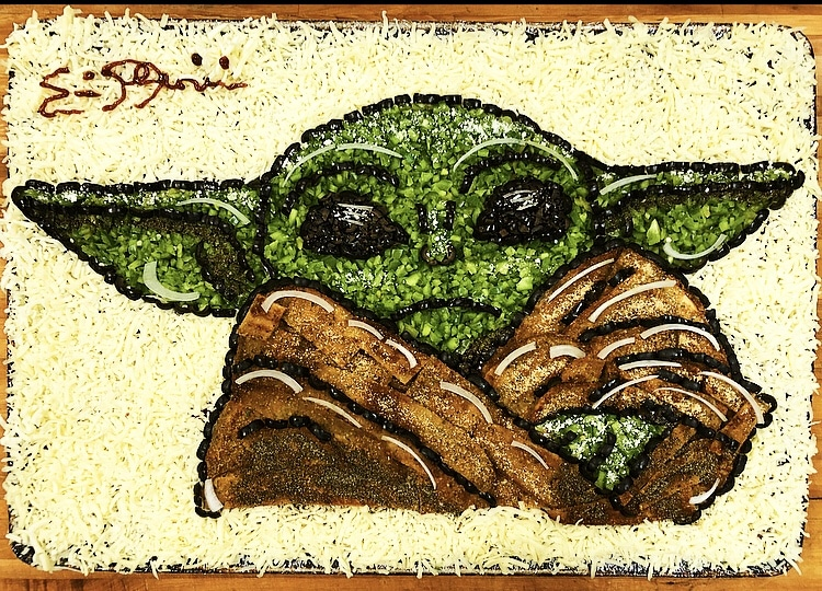 this baby yoda pizza is an example of pizza art by Eric Palmieri