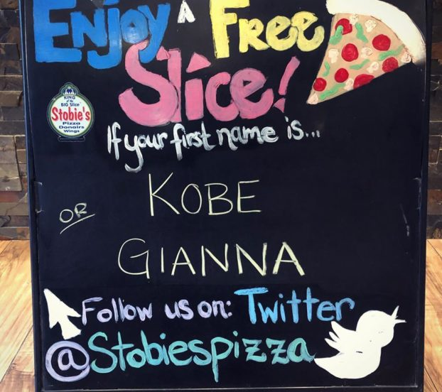this is a photo of the Stobie's Pizza board with Kobe and Gianna Bryant's name