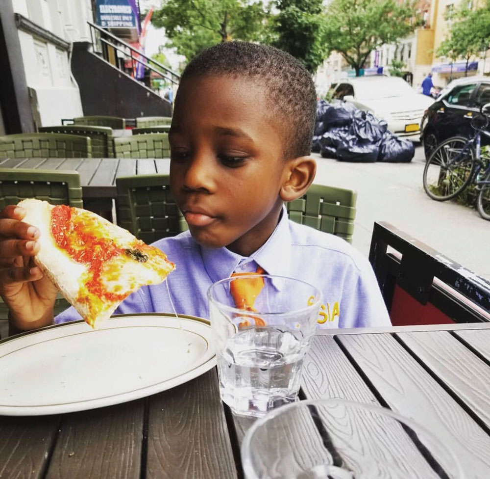 this photo depicts the family-friendly atmosphere at Harlem Pizza Co.