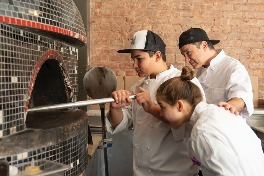 Harlem Pizza Co. owner Alper Uyanik and his two children