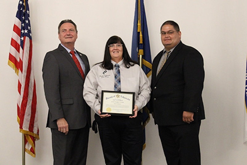 this photo shows Penne Carpenter accepting the Humanitarian Award from local law enforcement.