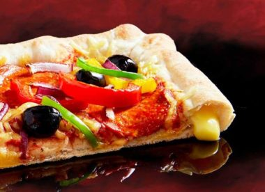 this is a photo of Pizza Hut UK's vegan cheese-stuffed crust pizza