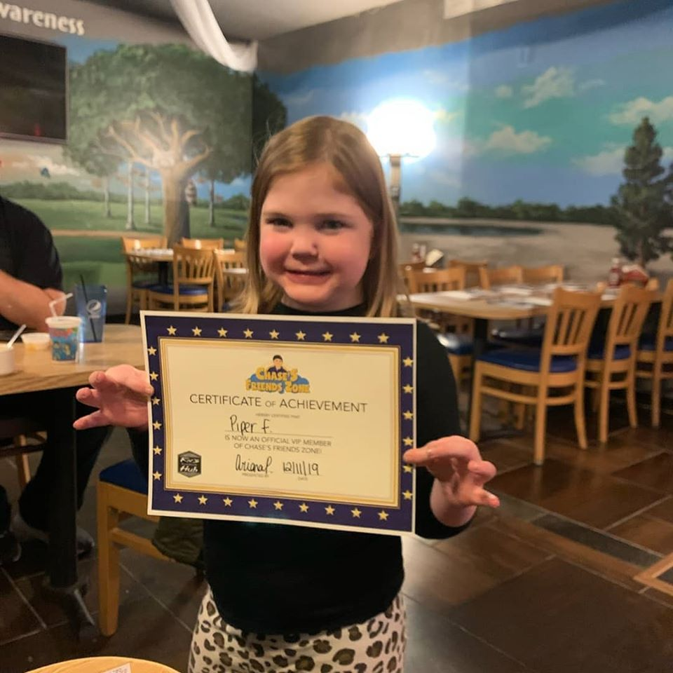 this is a photo of a child who received a VIP membership in the sensory friendly dining area at Riv's Toms River Hub