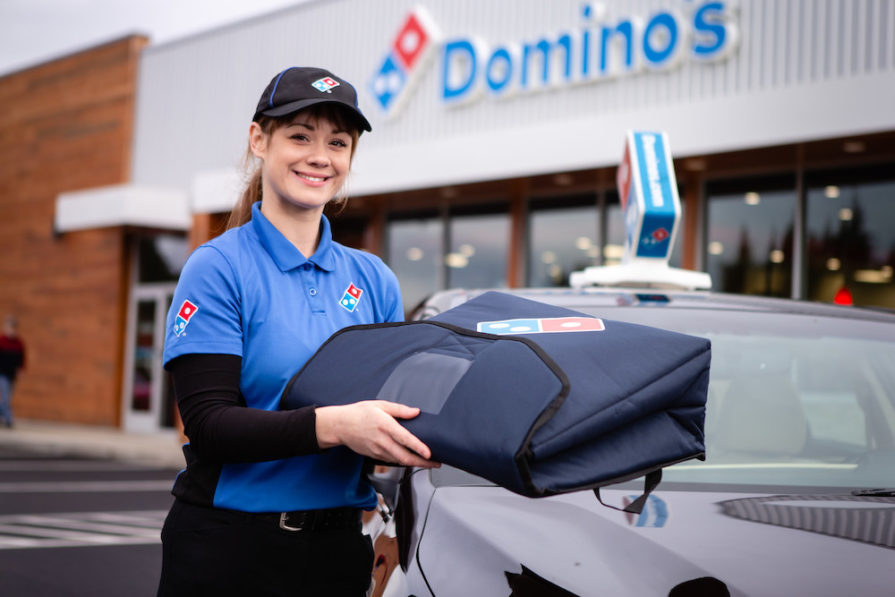 this photo shows a Domino's delivery driver