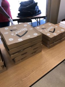 photo of boxes of pizzas donated by John Stetson of Stoner's Pizza Joint to a church in Fort Lauderdale, Fla.