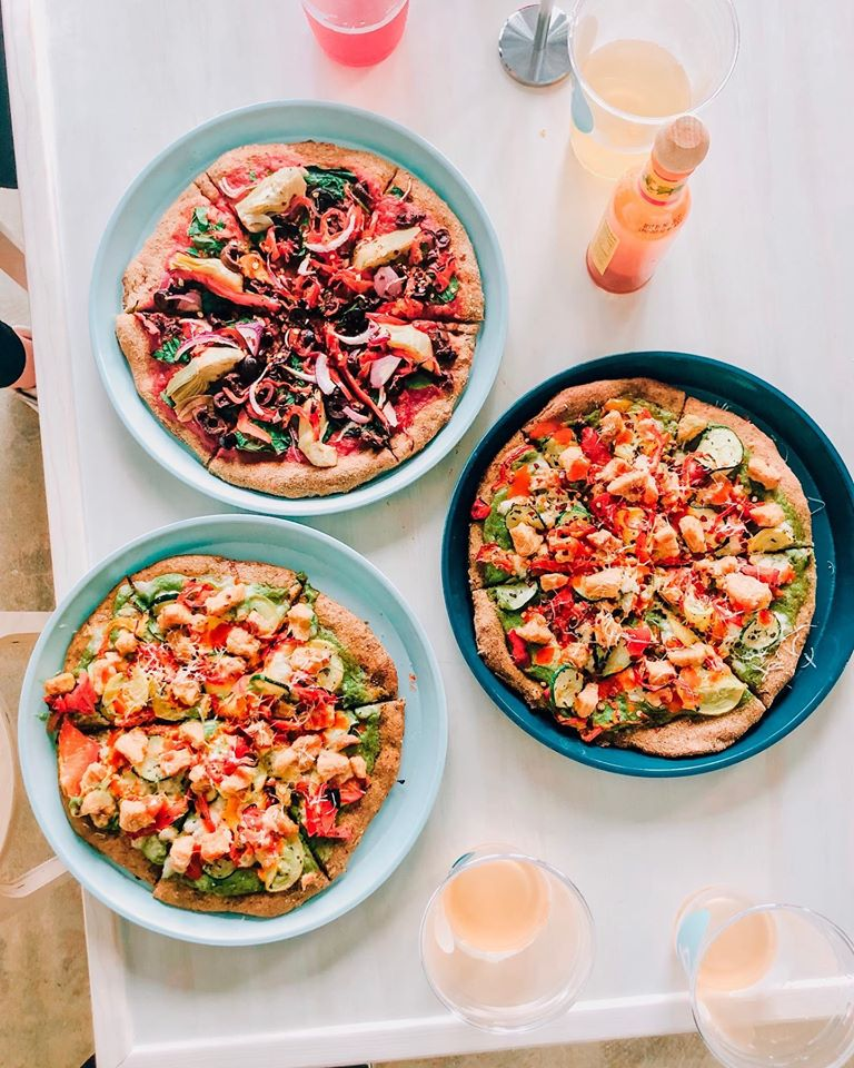 this photo shows various healthy pizzas at Powerhaus Wholesome Pizza & Eats in San Diego
