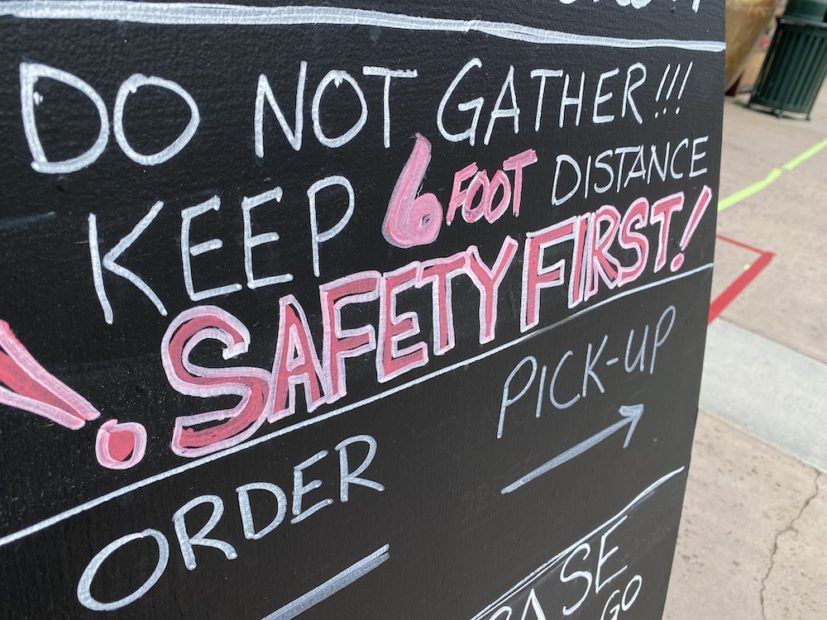 this photo shows a sign that stresses social distancing, an essential practice for restaurants reopening for business during the pandemic