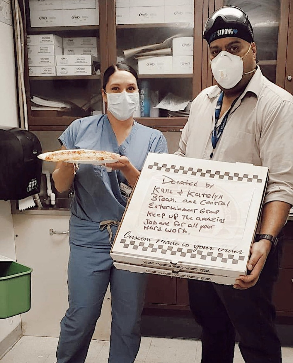 a photo of hospital workers receiving free pizza donated by country music star Kane Brown