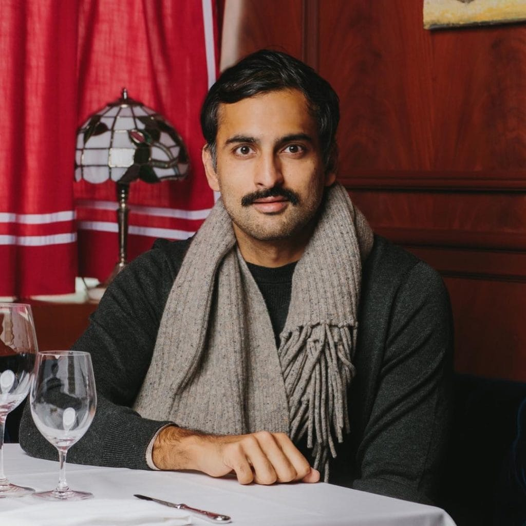 this is a photo of Syed Asim Hussain, co-owner of Black Sheep Restaurants and author of a playbook with tips for reopening your restaurant