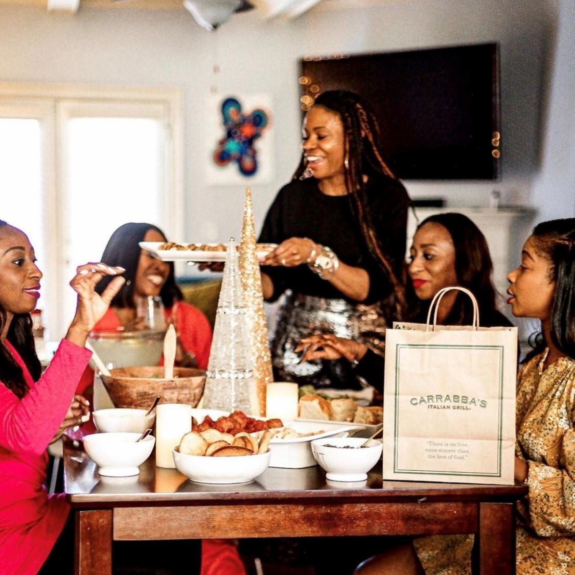 photo of a group of black women eating at Carrabba's, a restaurant chain that has been hit hard by the pandemic