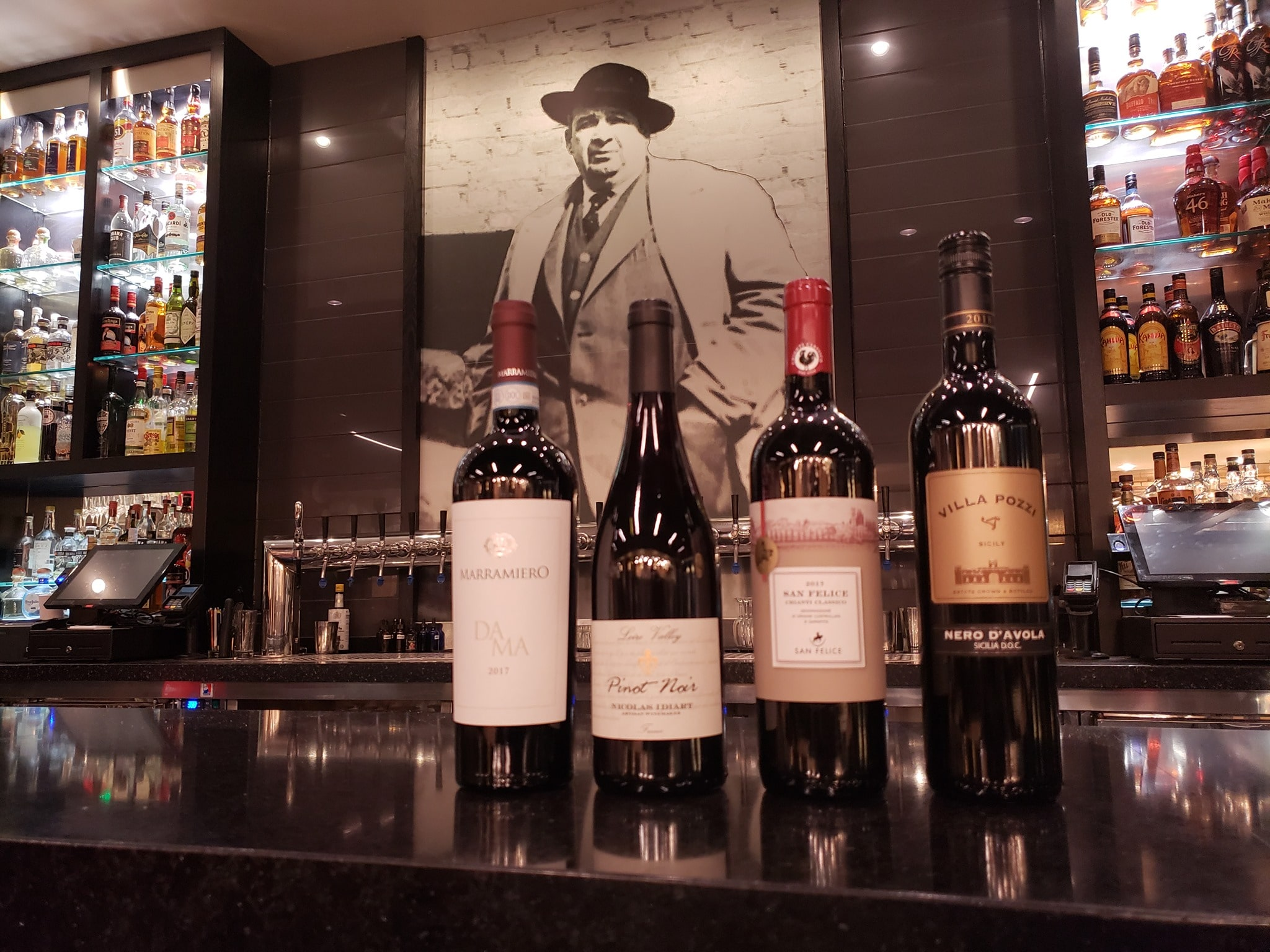 this photo shows a variety of wines that can be purchased to go from Mootz Pizzeria & Bar in Detroit.