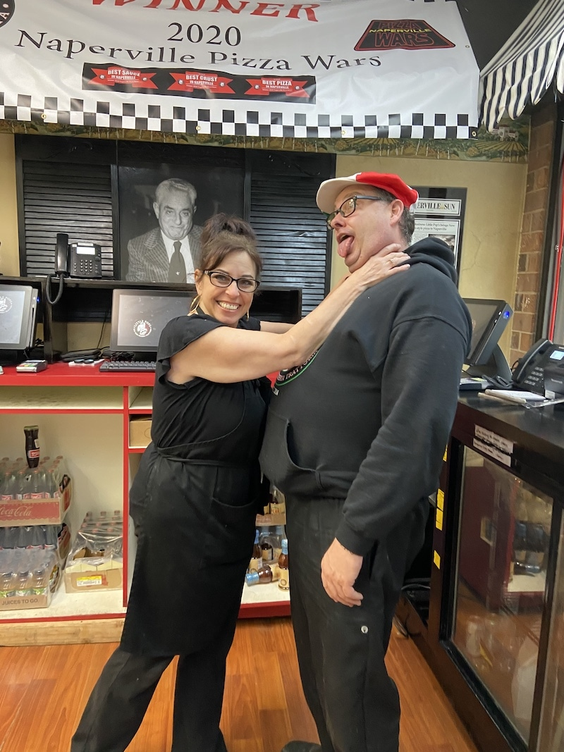 this photo shows Vicki Nelson pretending to choke husband Mike Nelson at Little Pops Pizzeria Trattoria