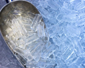 this photo shows a scoop dipping into the ice created by a restaurant's ice machine