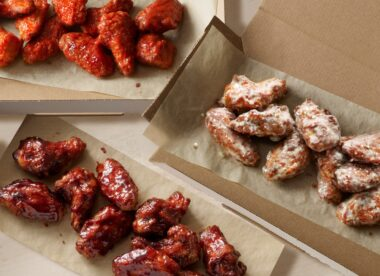 this photo shows several selections of new and improved chicken wings from Domino's