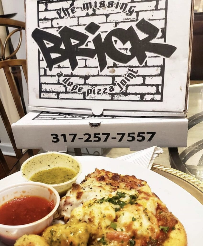 this photo shows a pizza called The Trap from The Missing Brick in Indianapolis