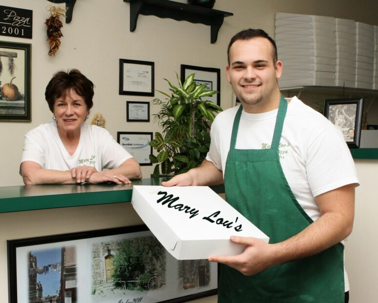 this photo shows the owner and an employee of Mary Lou's Pizza, an Old Forge-style pizza shop in Lackawanna County, Pennsylvania