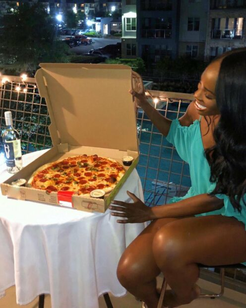 A customer opens a box of pizza at Zalat Pizza, which recently opened its second cloud kitchen