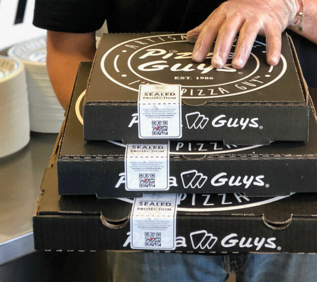 this photo shows the packaging for pizzas offered for carryout and curbside delivery by Pizza Guys