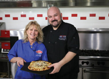 this photo shows Gail Churinetz of Gail's Pizza Parties with Brian Hernandez of PMQ