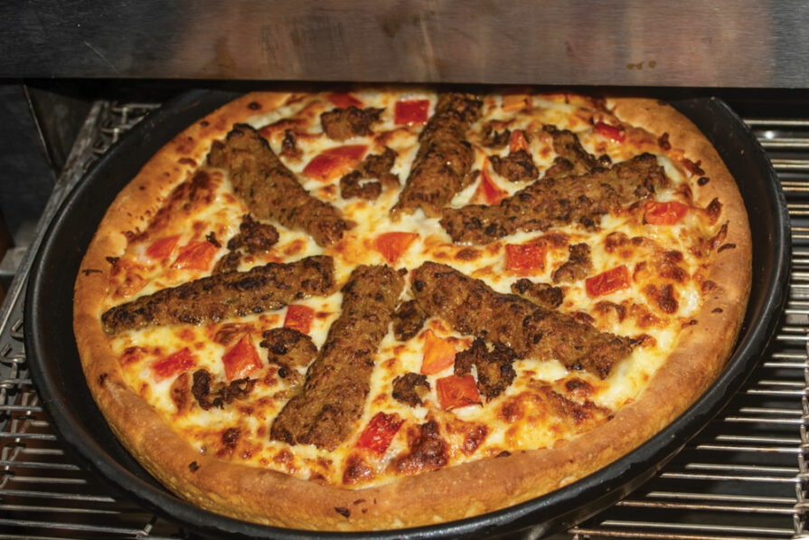 this photo shows a delicious pizza made in a conveyor oven