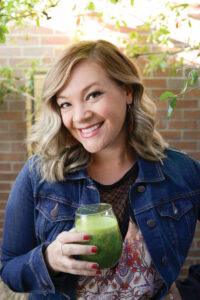 this photo shows Diana Edelman of Vegans, Baby with a veggie smoothie
