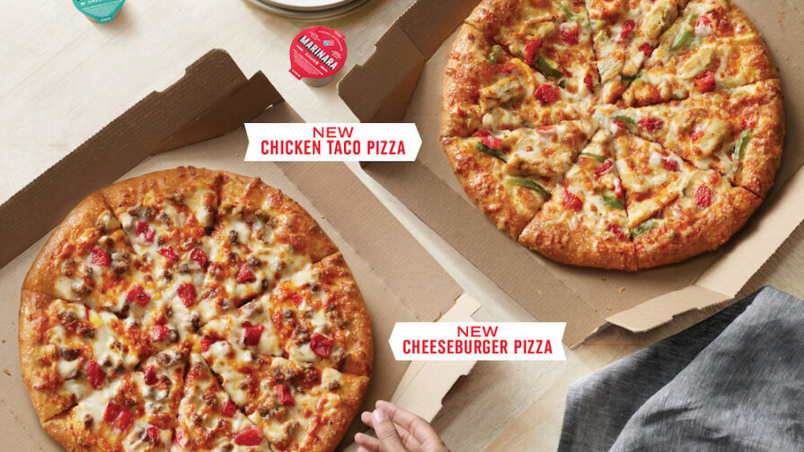 this photo shows the new cheeseburger pizza and taco chicken pizza from Domino's