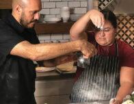 Janet Duran preps a pizza in the kitchen of her restaurant, 550 Pizzeria, in Laredo, Texas