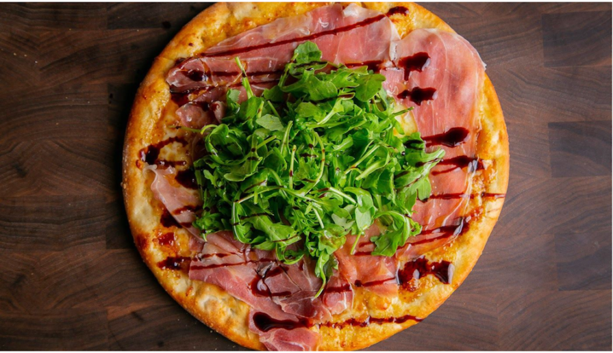 this photo shows the Prosciutto and Fig pizza developed by Russo's New York Pizzeria for Gluten-Free Diet Awareness Month