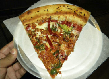 this photo shows the so-called world's hottest pizza, the Fiery Death w/ Hate Sausage pizza at Mikey's Late Night Slice
