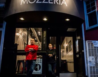this photo shows Melody Stein and Russ Stein, owners of Mozzeria, a deaf-owned restaurant in San Francisco and Washington, D.C.