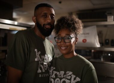 this photo shows Victor and Dana Cooksey in their Krazy Hog BBQ t-shirts as first restaurant in DoorDash's Reopen for Delivery program.