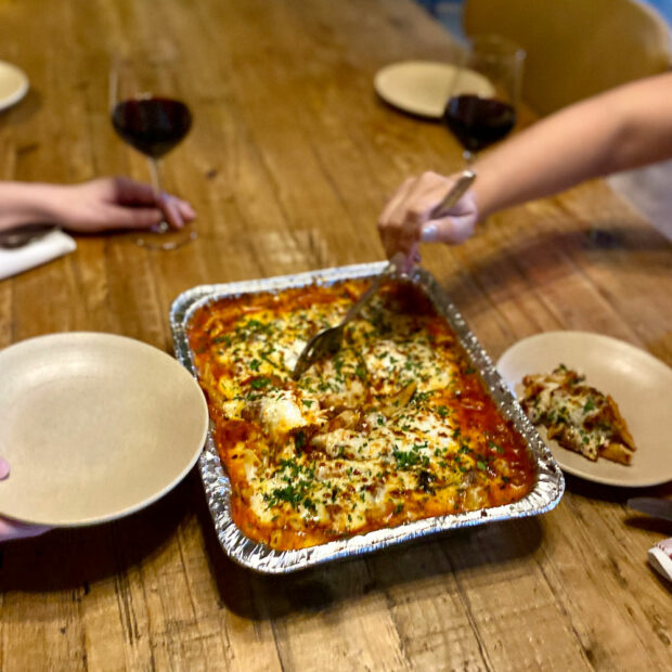 this is a photo of a tray of baked rigatoni bolognese with recipe included below