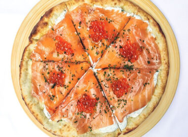 this is a photo of a delicious-looking smoked salmon pizza made by famous by Wolfgang Puck of Spago