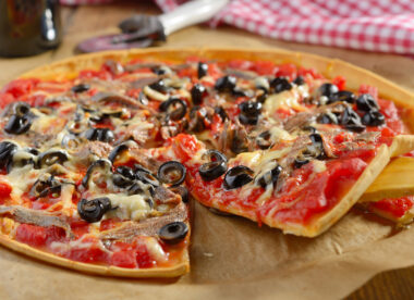 this is a photo of a pizza with the least popular pizza topping- anchovies