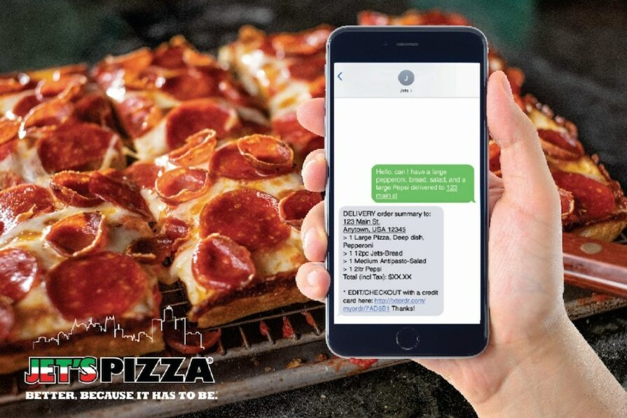 this photo shows a Jet's Pizza pie available through text-to-order driven by artificial intelligence
