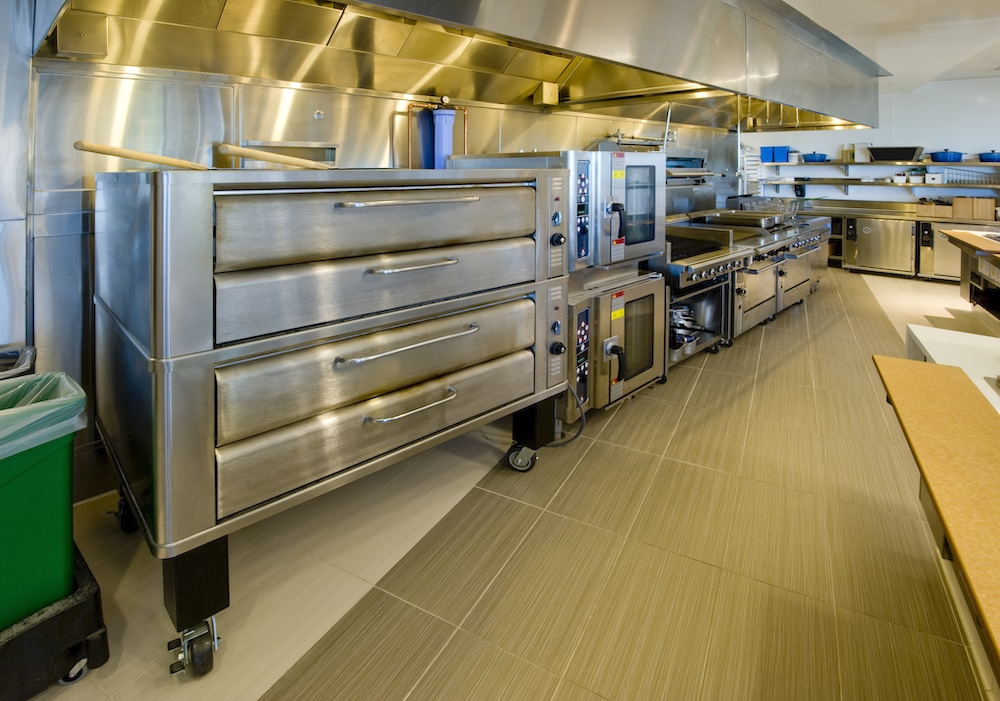 this photo shows a pizza kitchen and pizza oven, which must be well-maintained if you want to sell your pizzeria